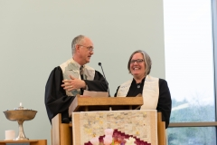 Rev. Paul Boothby giving charge to Minister