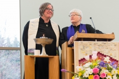 Rev. Jeanne Pupke giving charge to congregation